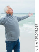 Купить «Senior man with arms outstretched at beach», фото № 30048529, снято 11 октября 2013 г. (c) Wavebreak Media / Фотобанк Лори