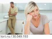 Купить «Angry couple after a fight in kitchen», фото № 30049193, снято 17 октября 2013 г. (c) Wavebreak Media / Фотобанк Лори