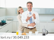 Купить «Woman embracing a happy man from behind in kitchen», фото № 30049233, снято 17 октября 2013 г. (c) Wavebreak Media / Фотобанк Лори