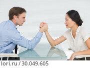 Купить «Business couple arm wrestling at desk», фото № 30049605, снято 3 ноября 2013 г. (c) Wavebreak Media / Фотобанк Лори