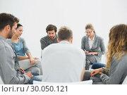 Купить «Group therapy in session sitting in a circle», фото № 30050121, снято 4 ноября 2013 г. (c) Wavebreak Media / Фотобанк Лори