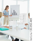 Купить «Casual business people in office at presentation», фото № 30050489, снято 4 ноября 2013 г. (c) Wavebreak Media / Фотобанк Лори
