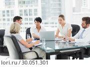 Купить «Well dressed business people in discussion at office», фото № 30051301, снято 2 ноября 2013 г. (c) Wavebreak Media / Фотобанк Лори