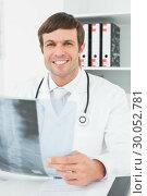 Купить «Smiling doctor with xray picture of spine in the medical office», фото № 30052781, снято 1 октября 2013 г. (c) Wavebreak Media / Фотобанк Лори