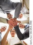 Купить «Happy business team looking down at the camera with hands together», фото № 30053789, снято 3 ноября 2013 г. (c) Wavebreak Media / Фотобанк Лори