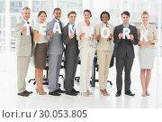 Купить «Diverse business team holding up letters spelling teamwork», фото № 30053805, снято 3 ноября 2013 г. (c) Wavebreak Media / Фотобанк Лори