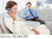Купить «Smiling businesswoman on the phone sitting on couch», фото № 30054305, снято 3 ноября 2013 г. (c) Wavebreak Media / Фотобанк Лори