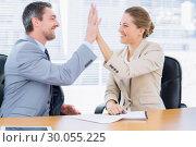 Купить «Smartly dressed colleagues giving high five in business meeting», фото № 30055225, снято 2 ноября 2013 г. (c) Wavebreak Media / Фотобанк Лори