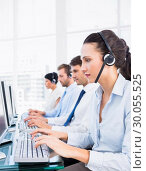 Купить «Business colleagues with headsets using computers», фото № 30055525, снято 2 ноября 2013 г. (c) Wavebreak Media / Фотобанк Лори