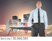 Купить «Composite image of happy businessman standing with hand in pocket», фото № 30060581, снято 10 января 2014 г. (c) Wavebreak Media / Фотобанк Лори