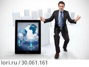 Купить «Composite image of businessman posing with arms outstretched», фото № 30061161, снято 10 января 2014 г. (c) Wavebreak Media / Фотобанк Лори