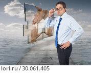 Купить «Composite image of thinking businessman tilting glasses», фото № 30061405, снято 11 января 2014 г. (c) Wavebreak Media / Фотобанк Лори