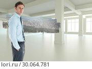 Купить «Composite image of serious businessman standing with hand in pocket», фото № 30064781, снято 11 января 2014 г. (c) Wavebreak Media / Фотобанк Лори