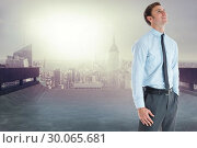 Купить «Composite image of smiling businessman standing with hand in pocket», фото № 30065681, снято 11 января 2014 г. (c) Wavebreak Media / Фотобанк Лори