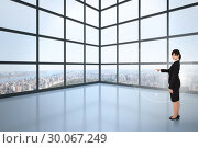 Купить «Composite image of focused businesswoman pointing», фото № 30067249, снято 15 января 2014 г. (c) Wavebreak Media / Фотобанк Лори