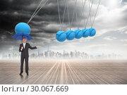 Купить «Composite image of peaceful businessman holding blue umbrella», фото № 30067669, снято 15 января 2014 г. (c) Wavebreak Media / Фотобанк Лори