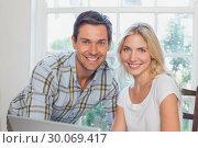 Купить «Happy young couple with laptop at home», фото № 30069417, снято 5 декабря 2013 г. (c) Wavebreak Media / Фотобанк Лори