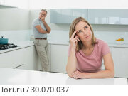 Купить «Couple not talking after an argument in kitchen», фото № 30070037, снято 18 октября 2013 г. (c) Wavebreak Media / Фотобанк Лори