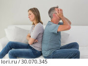 Купить «Unhappy couple not talking after an argument at home», фото № 30070345, снято 18 октября 2013 г. (c) Wavebreak Media / Фотобанк Лори