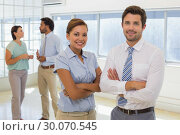 Купить «Portrait of a business couple with colleagues at office», фото № 30070545, снято 19 декабря 2013 г. (c) Wavebreak Media / Фотобанк Лори