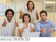 Купить «Happy business people gesturing thumbs up at office», фото № 30070721, снято 19 декабря 2013 г. (c) Wavebreak Media / Фотобанк Лори