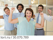 Купить «Cheerful business colleagues cheering in office», фото № 30070789, снято 19 декабря 2013 г. (c) Wavebreak Media / Фотобанк Лори