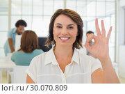 Купить «Smiling businesswoman gesturing ok sign with colleagues in meeting», фото № 30070809, снято 19 декабря 2013 г. (c) Wavebreak Media / Фотобанк Лори