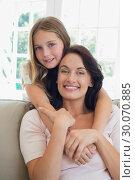 Купить «Girl embracing mother from behind at home», фото № 30070885, снято 18 декабря 2013 г. (c) Wavebreak Media / Фотобанк Лори