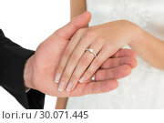 Купить «Cropped image of newly wed couple holding hands», фото № 30071445, снято 8 октября 2013 г. (c) Wavebreak Media / Фотобанк Лори