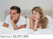 Купить «Couple not talking after an argument in bed», фото № 30071965, снято 17 декабря 2013 г. (c) Wavebreak Media / Фотобанк Лори