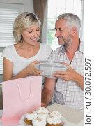Купить «Mature man giving a gift box to happy woman», фото № 30072597, снято 6 декабря 2013 г. (c) Wavebreak Media / Фотобанк Лори