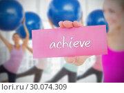 Купить «Fit blonde holding card saying achieve», фото № 30074309, снято 21 марта 2014 г. (c) Wavebreak Media / Фотобанк Лори