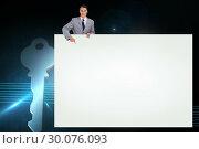 Купить «Composite image of businessman showing card», фото № 30076093, снято 22 марта 2014 г. (c) Wavebreak Media / Фотобанк Лори