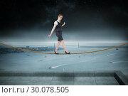 Купить «Composite image of businesswoman doing a balancing act», фото № 30078505, снято 28 марта 2014 г. (c) Wavebreak Media / Фотобанк Лори