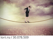 Купить «Composite image of businesswoman performing a balancing act», фото № 30078509, снято 28 марта 2014 г. (c) Wavebreak Media / Фотобанк Лори
