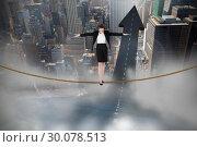 Купить «Composite image of businesswoman performing a balancing act», фото № 30078513, снято 28 марта 2014 г. (c) Wavebreak Media / Фотобанк Лори