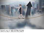 Купить «Composite image of businesswoman doing a balancing act», фото № 30078529, снято 28 марта 2014 г. (c) Wavebreak Media / Фотобанк Лори