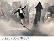 Купить «Composite image of businesswoman performing a balancing act», фото № 30078537, снято 28 марта 2014 г. (c) Wavebreak Media / Фотобанк Лори