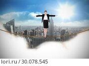 Купить «Composite image of businesswoman performing a balancing act», фото № 30078545, снято 28 марта 2014 г. (c) Wavebreak Media / Фотобанк Лори
