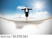 Купить «Composite image of businesswoman performing a balancing act», фото № 30078561, снято 28 марта 2014 г. (c) Wavebreak Media / Фотобанк Лори