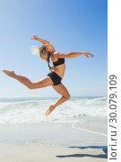 Купить «Fit blonde jumping gracefully on the beach», фото № 30079109, снято 14 февраля 2014 г. (c) Wavebreak Media / Фотобанк Лори