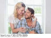 Купить «Cute smiling couple enjoying white wine together», фото № 30079889, снято 24 января 2014 г. (c) Wavebreak Media / Фотобанк Лори