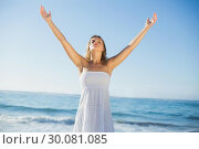 Купить «Beautiful blonde in white sundress on the beach», фото № 30081085, снято 12 февраля 2014 г. (c) Wavebreak Media / Фотобанк Лори