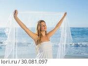 Beautiful calm blonde in white sundress on the beach with scarf. Стоковое фото, агентство Wavebreak Media / Фотобанк Лори