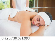 Купить «Beauty therapist rubbing womans back with heated mitts», фото № 30081993, снято 9 апреля 2014 г. (c) Wavebreak Media / Фотобанк Лори