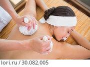 Купить «Smiling woman getting a back massage with herbal compresses», фото № 30082005, снято 9 апреля 2014 г. (c) Wavebreak Media / Фотобанк Лори