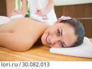 Купить «Smiling woman getting a back massage with herbal compresses», фото № 30082013, снято 9 апреля 2014 г. (c) Wavebreak Media / Фотобанк Лори