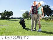 Купить «Golfing couple standing smiling at each other», фото № 30082113, снято 3 апреля 2014 г. (c) Wavebreak Media / Фотобанк Лори