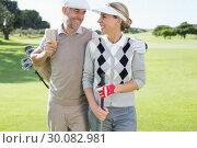 Купить «Golfing couple smiling at each other on the putting green», фото № 30082981, снято 3 апреля 2014 г. (c) Wavebreak Media / Фотобанк Лори