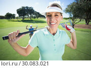 Купить «Lady golfer smiling at camera with partner cheering behind», фото № 30083021, снято 3 апреля 2014 г. (c) Wavebreak Media / Фотобанк Лори